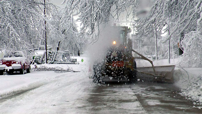 The Street Department works to clear roads following an ice and snow storm.
